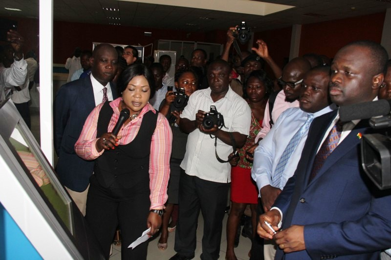 Mrs Veronica Boateng, a Director at NITA demonstrating some machine work to the Minister.