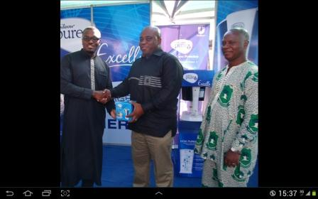 Mr Opoku-Asare, presenting the package to Dr Victor Bampoe, looking on is Dr Appiah Denkyira
