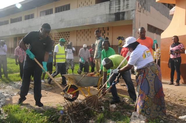Vice President Amissah-Arthur taking part in the clean-up at the Kanda Cluster of Schools.