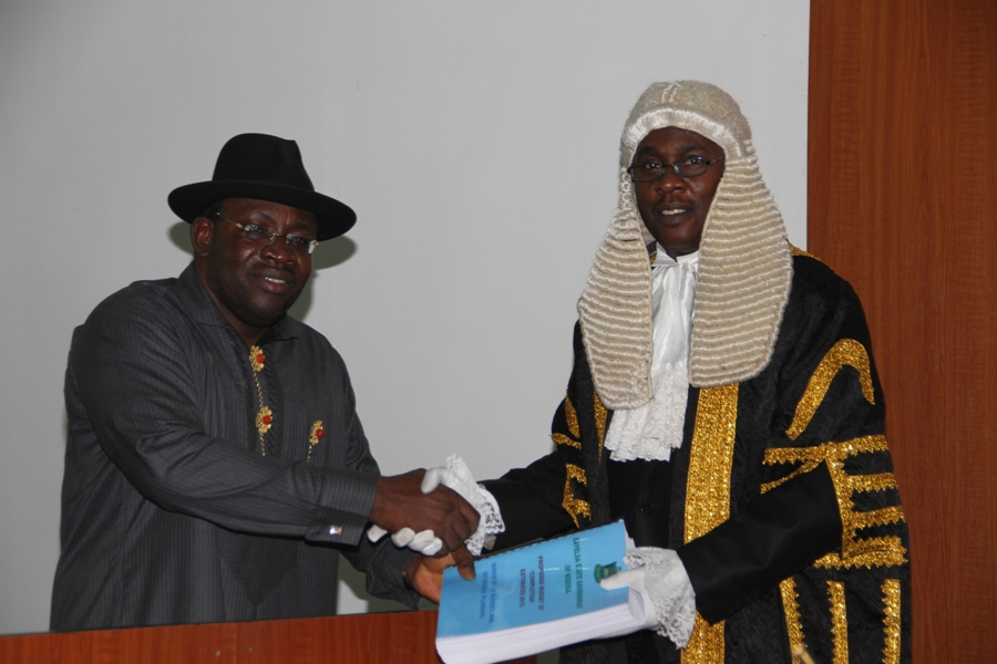 Bayelsa State Governor, Hon. Seriake Dickson (left) presenting the 2015 budget tagged (Budget of Completion ) to the Speaker of the State House of Assembly, Rt. Hon. Konbowei Benson (right) at the Assembly complex, Yenagoa.