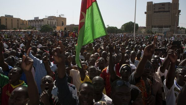 Pro-democracy protesters chant slogans against military rule at Place de la Nation in Ouagadougou, capital of Burkina Faso, November 2, 2014
