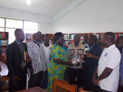 Rev Daniel Asante (right) presenting some of the books to the Kraboa Coaltar District Director of Education