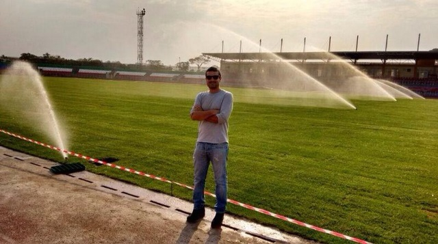 ?Ibergreen official standing by the relaid Mongomo Stadium playing pitch