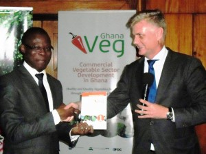 Mr Fiifi Kwetey (left), Minister of Food and Agriculture receiving the report from Mr Hans Docter, the Netherlands Ambassador to Ghana
