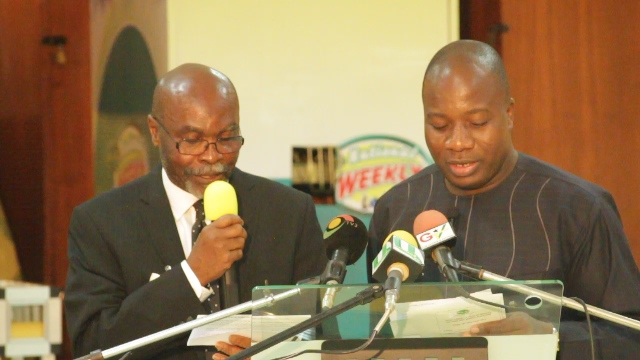 Mr Mahama Ayariga, Minister of Youth and Sports and Brigadier-General Martin Ahiaglo, Acting Director General of National Lotteries Authority launching the Sports Lottery game