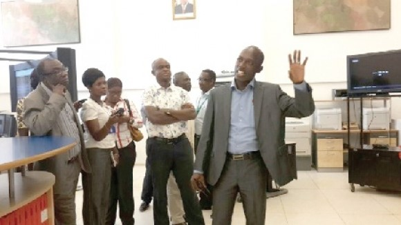 Mr William Amuna (with hand raised), the CEO of GRIDCo, briefing Dr Kwabena Donkor (left) during the visit.