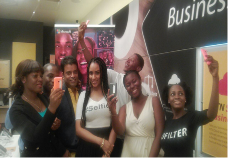 Juliet Ibrahim taking a selfie with funs