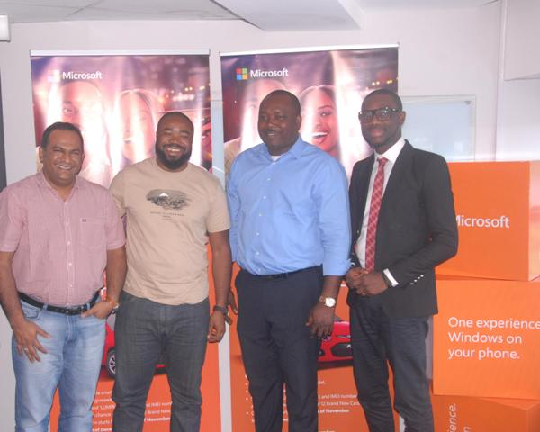 L-R: Regional Manager, Midcom, Sivadoss Vijayakumar; Senior Business Manager, West Africa, Microsoft Mobile Devices and Services, Paul Okeugo; Head Regulation & Monitoring, National Lottery Regulatory Commission, Jude Ogaga Ughwujabo; and Senior Product Manager, Microsoft Mobile Devices and Services, West and Central Africa, Olumide Balogun; during the Lumia Christmas Promo first draw which took place on the 4th of December at Microsoft Mobile Devices and Services Office in Lagos.