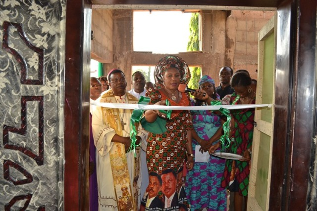 Wife of Anambra State governor, Chief Mrs. Ebelechukwu Obiano,cutting the tape to commission the Bakery and Knitting Centre, first left is the Catholic Bishop of Awka Diocese, Most Rev. Dr. Paulinus Ezeokafor at the Commissioning of the Bakery and Knitting Centre of the Saint John?s Vocational and Technical (VOTEC), Neni, Anaocha Local Government Area, Anambra State.