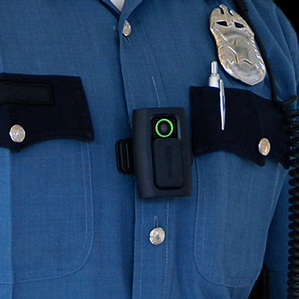 Some police are now using wearable cameras to record interactions with the public. The one shown here was made by a company called Vievu.