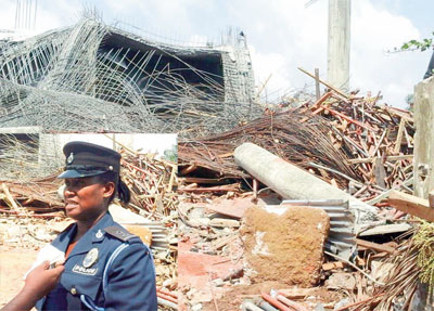 The collapsed building, INSET: ASP Tenge speaking to a journalist at the scene