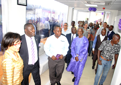 Karen Akiwumi-Tanoh, Board Chairperson of the bank (extreme left) supported by Daniel Addo, Executive Director of the bank, to welcome invited guests into the new banking hall.