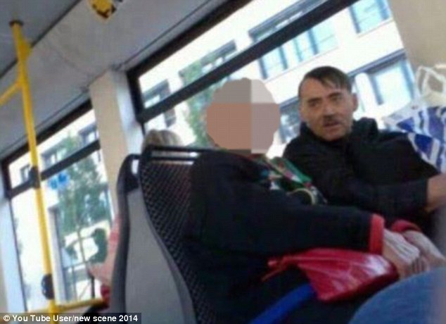 Emin Djinovci (right) from Mitrovica earns a living as a Hitler look-a-like and even charges tourists ?60 for taking a photograph with him