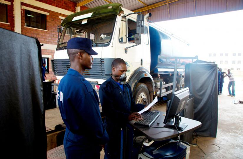 Traffic Police check a lorry at the Motor Vehicle Control Unit in Remera. (Timothy Kisambira)
