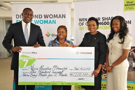 Head, Direct Banking, Diamond Bank PLC, Jude Anele; DiamondXtra Salary-4-Life winner, Duru Chukwuebuka Francis; and Head, Retail Banking Directorate, Diamond Bank PLC, Aisha Ahmad at the Diamondxtra Season 7 Year-End/ Diamond Woman Special Draw prize presentation ceremony, held at the Bank?s corporate head office recently.