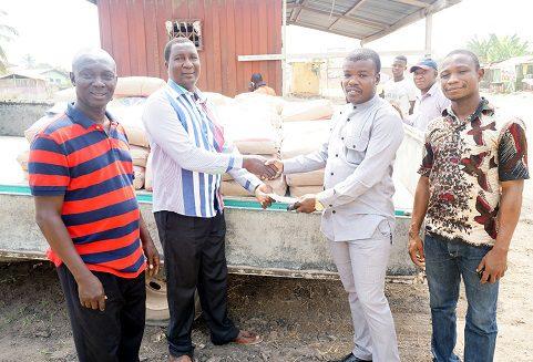Bright K. Demordzi, ,MP for Bortianor/NgleshieAmanfro Constituency, presenting donation