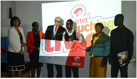 Hannah Agbozo, Director of Legal & Corporate Affairs; Lucy Quist, Managing Director; Christophe Soulet, Executive Operations Director, SBU2, Airtel Africa; Michael Ahedor, Touching Lives Recipient and his family