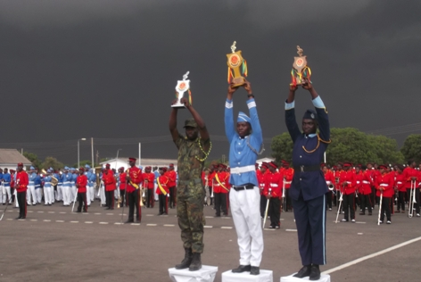 drum majors of Victory Band, Prempeh College and Kumasi Technical Institute with their trophies