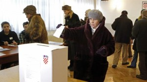 A Croatian woman casts her ballot in the capital Zagreb, December 28, 2014.