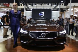 A model poses with a Volvo concept car at Auto China 2014 in Beijing April 20, 2014. China is set to surpass the United States to become Volvo Car Group?s biggest market in 2014 with sales of at least 80,000 cars in the world?s largest auto market.