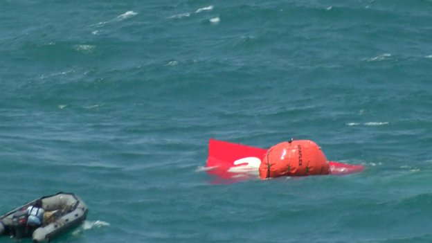 Divers used an inflatable device to pull the tail to the sea?s surface