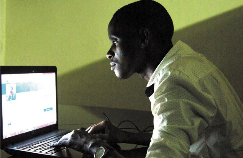 A young man surfs the internet. Social media platforms such as Facebook and WhatsApp are being used to market pornography. (File)