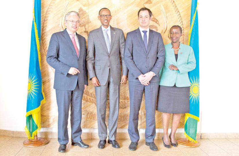 President Paul Kagame poses with Alexander De Croo, the Belgian development cooperation minister (2nd R), and foreign ministers Didier Reynders (L) and Louise Mushikiwabo of Belgium and Rwanda, respectively, at Village Urugwiro yesterday. (Village Urugwiro)