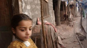 The file photo shows a girl in a refugee camp for Kashmiri villagers.