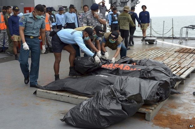 Victims in body bags were hoisted aboard a warship