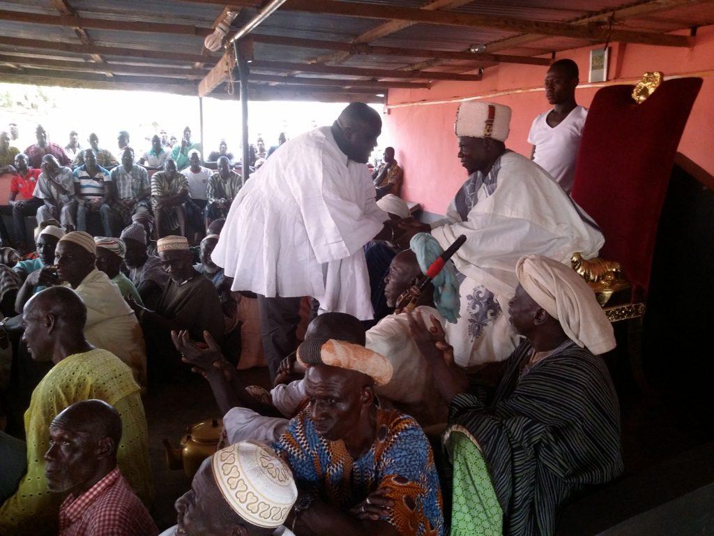 Mr Debrah, Local Government Minister wearing the white smock presented to him in a hand shake with the Regent of Dagbon, Kampakuya-Naa Abdulai Yakubu Andani