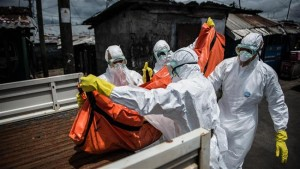 The file photo shows health workers carrying the body of an Ebola patient in Sierra Leone.