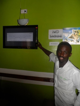 John Maloba, a waiter at Fralian Hotel in Kakamega town, flips through his TV channels after the Communications Authority of Kenya switched off the analogue signal, Saturday. PHOTO: CHRISPEN SECHERE/STANDARD