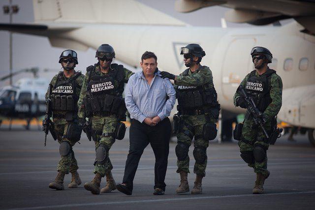Army personnel escort Omar Trevino Morales, head of north Mexico's Los Zetas drug cartel, in Mexico City March 4, 2015. (Xinhua/Pedro Mera)