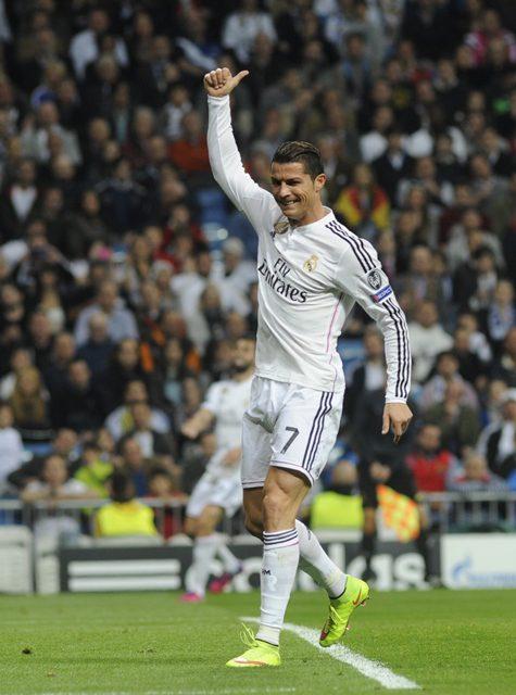 Real Madrid's Portuguese forward Cristiano Ronaldo celebrates his goal during the Champions League football match 2nd leg against Schalke 04 at Santiago Bernabeu Stadium in Madrid, Spain, March 10, 2015. (Xinhua/Eduardo Dieguez)