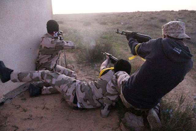 Some Libya Dawn fighters shoot their guns near Libya's capital city of Tripoli, on March 11, 2015. Clashes erupted on Wednesday between Libya Dawn militants and pro-government forces in the Ajaylat area some 80 kilometers west of Tripoli. (Xinhua/Hamza Turkia)