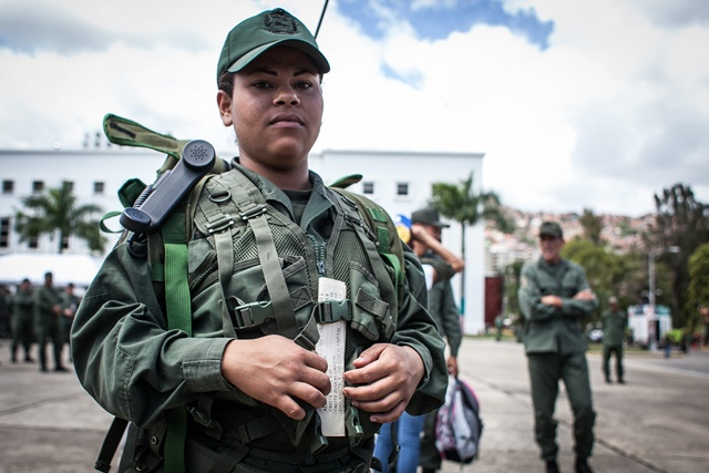 A female soldier takes part in the military exercises convened by Venezuelan President Nicolas Maduro, in Caracas, Venezuela, on March 14, 2015. Venezuelan Defense Minister Vladimir Padrino Lopez inaugurated the ten-day military exercises on Saturday, which he said was launched due to the urgent need to defend the integrity of the nation. (Xinhua/Boris Vergara) (jg)