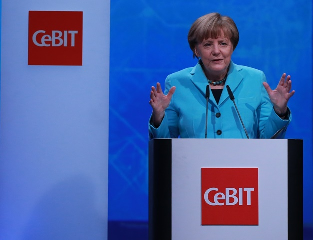 German Chancellor Angela Merkel delivers a speech during the opening ceremony of CeBIT 2015 in Hanover, Germany, on March 15, 2015. Top IT business fair CeBIT 2015, which features a strong Chinese presence, kicked off on Sunday in Germany. (Xinhua/Luo Huanhuan)