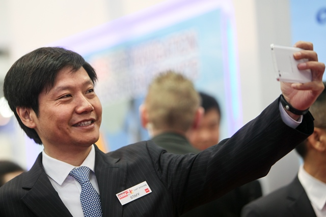 China's Xiaomi Tech's CEO Lei Jun takes a selfie with his cellphone at 2015 CeBIT Technology Trade fair in Hanover, Germany, on March 16, 2015. Top IT business fair CeBIT 2015, which features a strong Chinese presence this year, opened on Sunday in Hanover. (Xinhua/Zhang Fan)