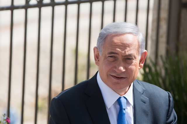"Israeli Prime Minister Benjamin Netanyahu attends a campaign trail in the east Jerusalem Jewish settlement of Har Homa, on March 16, 2015. Israeli Prime Minister Benjamin Netanyahu told an Israeli news website Monday that if he is elected in Tuesday's national elections, ""there will be no Palestinian state."" (Xinhua/JINI)"