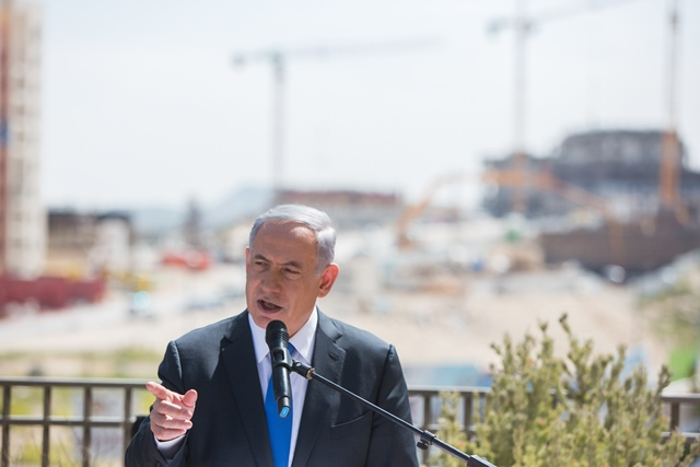 "Israeli Prime Minister Benjamin Netanyahu addresses a campaign trail in the east Jerusalem Jewish settlement of Har Homa, on March 16, 2015. Israeli Prime Minister Benjamin Netanyahu told an Israeli news website Monday that if he is elected in Tuesday's national elections, ""there will be no Palestinian state."" (Xinhua/JINI)"