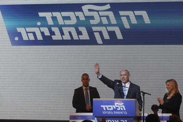 Israeli Prime Minister and Likud Party leader Benjamin Netanyahu (2nd R) waves to supporters with his wife Sara (1st R) at Likud Party campaign headquarters in Tel Aviv, Israel, on March 18, 2015. Israel's incumbent Prime Minister Benjamin Netanyahu claimed victory following exit polls showing him tied with opposition center-left Zionist Union led by Isaac Herzog in Tuesday's parliamentary elections. (Xinhua/JINI)(lyi)