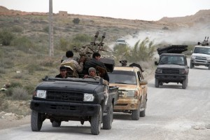 Some Libya Dawn fighters go into the combat zone on their armed vehicles near Bir al-Ghanam, Libya, on March 21, 2015. Clashes continued between Libya Dawn fighters and pro-government forces on Saturday near Bir al-Ghanam, some 90 kilometers southwest of the capital Tripoli. (Xinhua/Hamza Turkia)