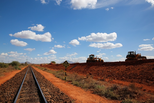 Bulldozers work at a construction site on section two of Kenya's Standard Gauge Railway project, companied with a segment of old railway, near Voi, Kenya, on March 19, 2015. The project, expected to cost 3.8 billion U.S. dollars, involves the construction of about 480 kilometer railway line from the port city Mombasa to the capital city Nairobi. China Roads and Bridges Corporation (CRBC) is undertaking the project. (Xinhua/Pan Siwei)
