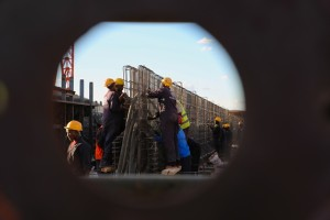 Workers work at the T-beam factory on section six of Kenya's Standard Gauge Railway project, near Makueni, Kenya, on March 16, 2015. The project, expected to cost 3.8 billion U.S. dollars, involves the construction of about 480 kilometer railway line from the port city Mombasa to the capital city Nairobi. China Roads and Bridges Corporation (CRBC) is undertaking the project. (Xinhua/Pan Siwei)