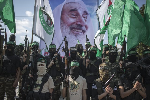 Palestinian Hamas militants take part in a parade to mark the 11th anniversary of the Israeli assassination of Hamas spiritual leader Sheikh Ahmed Yassin in Gaza city, on March 22, 2015. (Xinhua/Wissam Nassar)