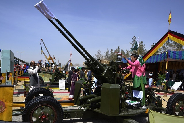 Pakistani civilians visit an exhibition during the National Day ceremony in southwest Pakistan's Quetta on March 23, 2015. On March 23, 1940, the historic Pakistan Resolution was adopted in the eastern city of Lahore, which led to creation of a separate homeland for the Muslims of the Indian Subcontinent. (Xinhua/Asad)