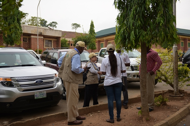 International observers are seen at a polling station before the election begins in Abujia, Nigeria, March 28, 2015. Polling stations across Nigeria opened on Saturday amid tight security, as more than 56 million eligible voters went there to cast their ballots to elect a new president, Nigeria's Independent National Electoral Commission said. (Xinhua/Yang Yang)