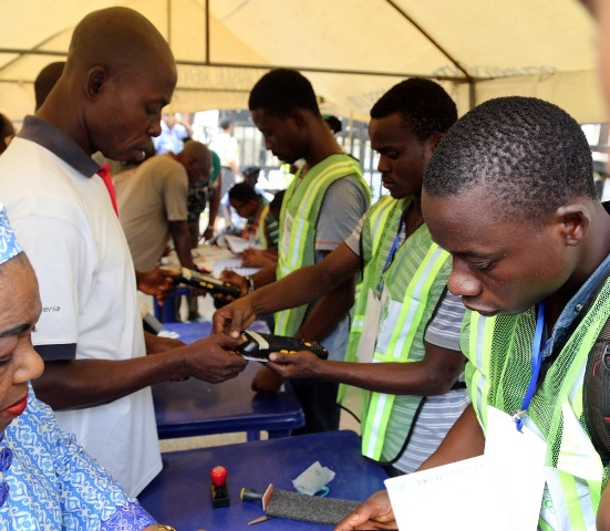 The Independent National Electoral Commision (INEC) officials register voters in Lagos, Nigeria, on March 28, 2015. Polling stations across Nigeria opened on Saturday amid tight security, as more than 56 million eligible voters went there to cast their ballots to elect a new president, Nigeria's Independent National Electoral Commission said. (Xinhua/Idowu Ogunleye)
