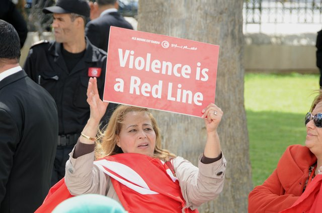 """A woman holds a placard during the international anti-terrorism march in Tunis, Tunisia, on March 29, 2015. Tunisia held an international anti-terrorism march entitled """"The World is Bardo"""" on Sunday, 11 days after the deadly terrorist attack against the Bardo museum. (Xinhua/Adel)"""