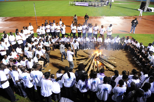 """Youth surround a bonfire during the ?Night Vigil? as part of events to mark the 18th Genocide Commemoration in Kigali, capital of Rwanda, April 7, 2012. Youth use the ?Night Vigil? to remember innocent Tutsis killed in the 1994 genocide. The theme of this year?s anniversary is: """"Learning from our history to build a bright future"""". (Xinhua/Cyril Ndegeya) (cl)"""